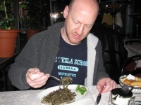 Phil Eating Squid in Ink Sauce